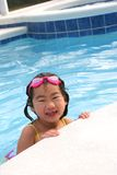 Girl playing in swimming pool Stock Image