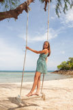Girl playing the swing on beach Royalty Free Stock Images