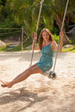 Girl playing the swing on beach Royalty Free Stock Image