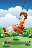 Girl playing swing in a park Royalty Free Stock Photo