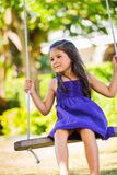 Girl Playing on Swing Set Stock Image