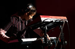 Girl playing on synthesizer royalty free stock photo