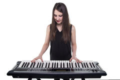 Girl playing on synthesizer Royalty Free Stock Photos