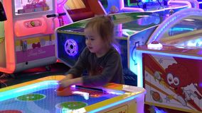 Girl playing table air hockey arcade game. Moscow, Russia - March, 2017: Girl playing table air hockey arcade game stock footage