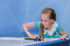 Girl playing table hockey Stock Photo