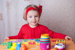Girl playing at table in nursery Stock Photos