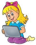 Girl playing with tablet Royalty Free Stock Photography