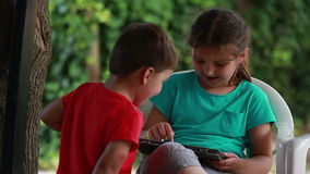 Girl playing on the tablet stock video footage