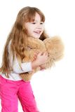 Girl playing with teddy bear Royalty Free Stock Image