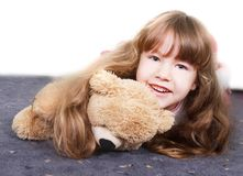 Girl playing with teddy bear Royalty Free Stock Images