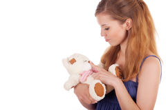 Girl playing with teddy bear Royalty Free Stock Photo