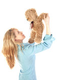 Girl playing with teddy bear Stock Photos