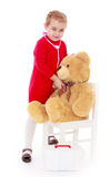 Girl playing with a Teddy bear in the hospital Royalty Free Stock Images