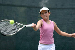 Girl playing tennis Stock Image