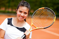 Girl playing tennis Stock Photography