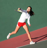 Girl playing tennis royalty free stock images