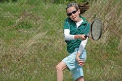 Girl playing tennis. Action shot of girl playing tennis Royalty Free Stock Image