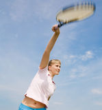 Girl playing tennis on background of sky Stock Photo