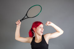 Girl playing tennis. Portrait of a girl playing tennis royalty free stock photo