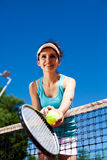 Girl Playing Tennis, summertime saturated theme Royalty Free Stock Photo