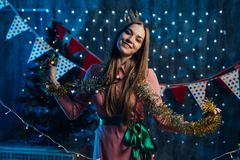 Girl playing with tinsel Christmas New Year. royalty free stock photography