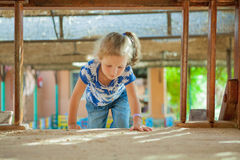 The girl playing to a sandbox Stock Photography