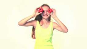 Girl playing with tomatoes stock footage