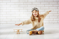 Girl playing with toy airplane Royalty Free Stock Images