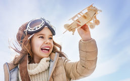 Girl playing with toy airplane Royalty Free Stock Image