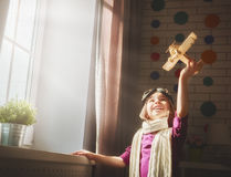 Girl playing with toy airplane Stock Images
