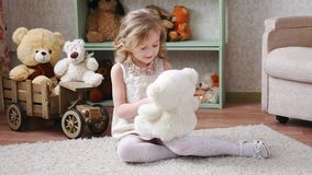 Girl playing with a toy bear 4k stock video