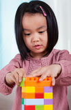 Girl playing toy blocks Royalty Free Stock Image