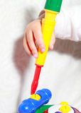 Girl playing toy Royalty Free Stock Photo