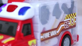 Girl playing with toy fire-engine vehicle. Girl playing with toy fire-engine vehicle close-up stock video