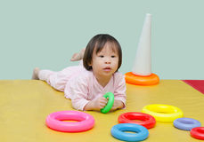 Girl playing toy on floor Stock Photo
