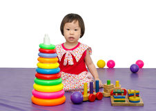 Girl playing toy on floor Royalty Free Stock Images