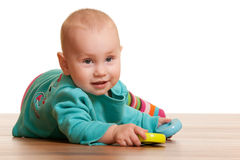Girl is playing with toy pyramid on the floor Royalty Free Stock Photo