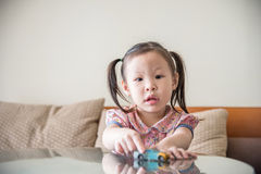 Girl playing toy on table Royalty Free Stock Images