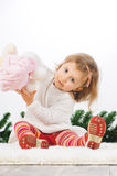 Girl Playing with Toy Royalty Free Stock Image