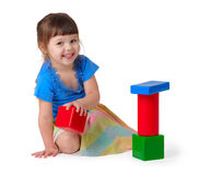 Girl playing with toys Stock Photography