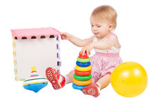 Girl playing toys Royalty Free Stock Photography