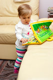Girl playing with toys Stock Image