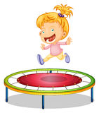 A girl playing trampoline Stock Images