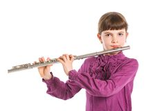 Girl playing transverse flute. Portrait of a cute girl playing transverse flute. Isolated on a white background Stock Photos