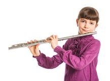 Girl playing transverse flute Royalty Free Stock Image