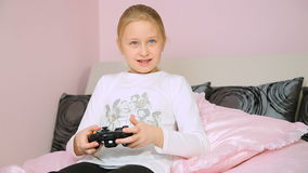 Girl playing video console game and win