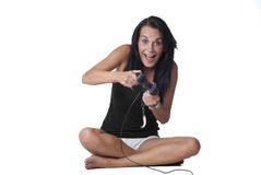 Girl playing video game Stock Photos