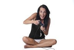 Girl playing video game Stock Photos