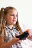 Girl playing video game. Stock Images