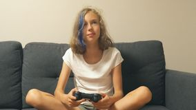 Girl playing video game at home. Pretty girl playing video game at home stock video footage